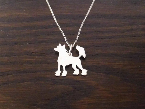 chinese crested pendant sterling silver handmade by saw piercing